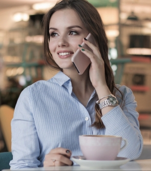 woman speaking on phone, conversation etiquette from balissande finishing school