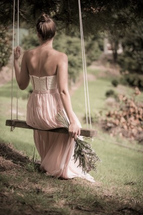 elegant woman on swing contemplating why etiquette is important